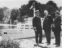 The Second Lord Gretton with Mr H.A. Marshall, Commodore and Mr C.S Birch